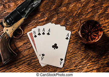 Wild Bill Dead Mans Hand with a whiskey shot and a colt...
