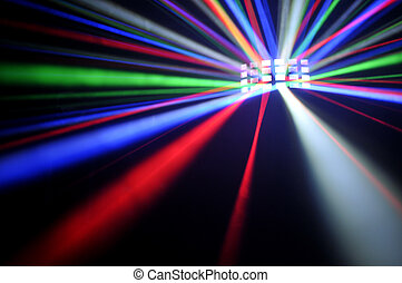 Disco light effect - Light colored rays on a black...