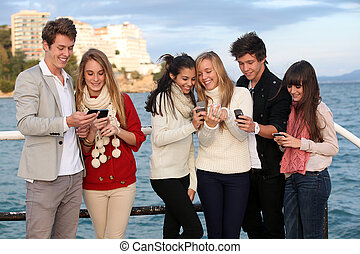 kids with mobile or cell phones - kids texting with mobile...