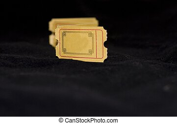 Empty yellow color ticket on isolated black background