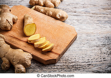 ginger root sliced - Cutting board with ginger root sliced