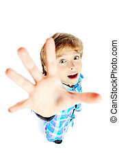 reaching - Portrait of a 9 year boy pulling his hand up...