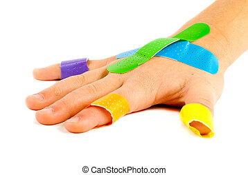 Bandage-on-child-hand - Colorful bandages on child's hand.
