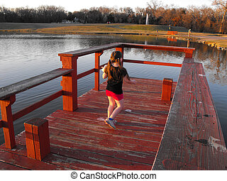 Evening at the Lake - Child playing on dock at Waterloo Lake...