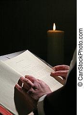 Preacher reading the Bible