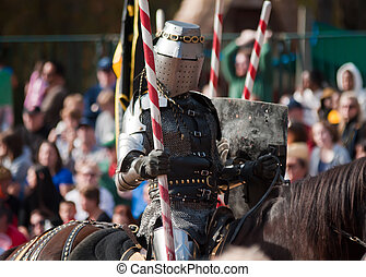armored joust knight - Armored rider with lance on horse