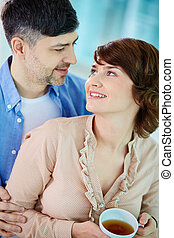 Sweethearts - Portrait of happy middle aged couple looking...