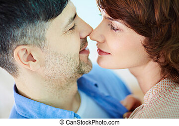 Closeness - Portrait of tender couple looking at one another