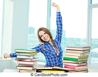 A bit of rest - Portrait of diligent student relaxing during...