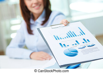 Showing document - Image of business document being shown by...