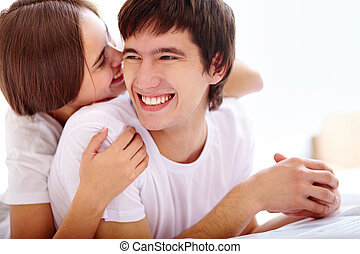 Laughing - Portrait of happy young couple laughing