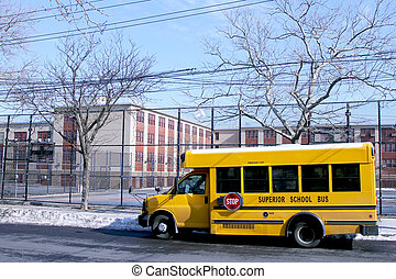 School bus next to public school - BROOKLYN, NEW YORK -...