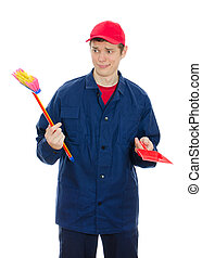 Young male cleaner holding small brush and scoop. Isolated on white