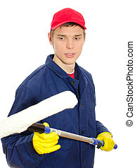 Young male window cleaner with wiper. Isolated on white