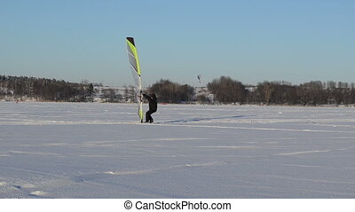 man catch wind surfing - man with ice sail tool try to catch...