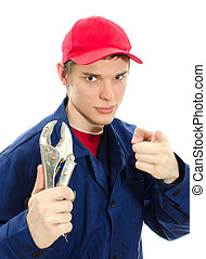 Young male plumber in uniform with wrench. Isolated on white