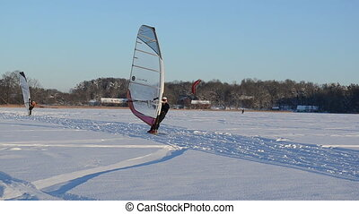 ice sail surf snow people - TRAKAI, LITHUANIA - CIRCA...