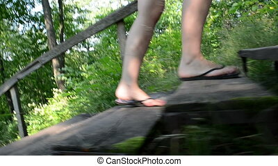 woman climb stais park - follow woman in flip-flop shoes...