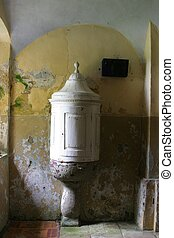 Baptismal font in old church