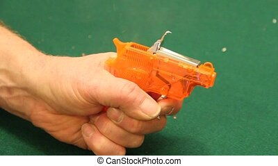 toy cap gun being fired