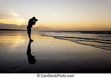 photographer at the sunset beach
