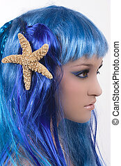 Mermaid with beautiful make up and starfish