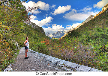 Velebit trail - Beautiful woman hinking a trail in Velebit...
