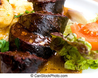 Traditional French cuisine Boudin Noir on table