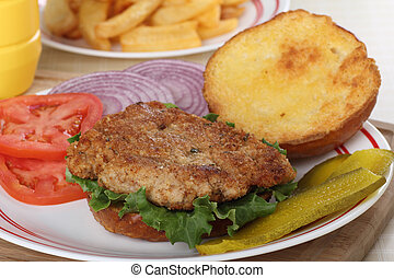 Pork Tenderloin Sandwich - Pork tenderloin and lettuce on a...