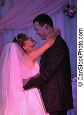 Wedding couple dancing - Bride and groom dancing their first...