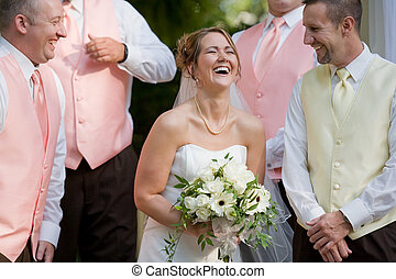 Bride Laughing Surrounded by the Groomsman