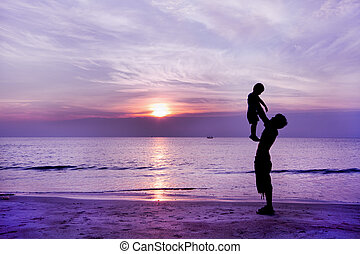Happy family having fun on the beach,Father and son play on...