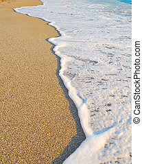 Sandy Beach and Foamy Surf. Summer Background