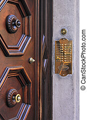 Door intercom and bell buttons in brass