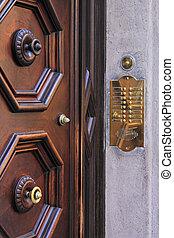 Door intercom and bell buttons in brass