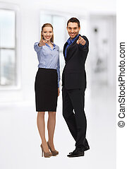 man and woman pointing their fingers - bright picture of man...
