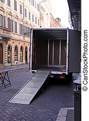 Truck loading ramp - Empty moving truck with loading ramp at...