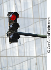 Red Traffic light - Red traffic light in front of the glass...