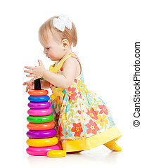 girl building pyramid on floor on white background