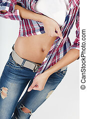 attractive body of the girl in jeans and a plaid shirt