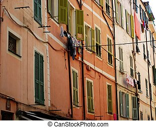 San Remo, Italy - Colorful houses in the small alleys of old...