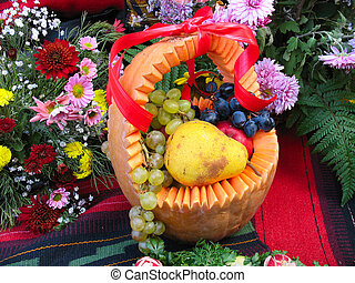 pumpkin basket with autumn harvest fruit and vegetables