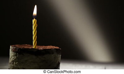 One candle in tiramisu cake. Birthday vintage background.
