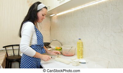 Woman Cooking In The Kitchen - Woman Cooking Meat Pasty On...
