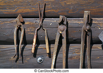 Old rust tools on wooden background