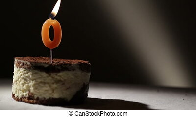 Candle o in tiramisu cake. Birthday vintage background.