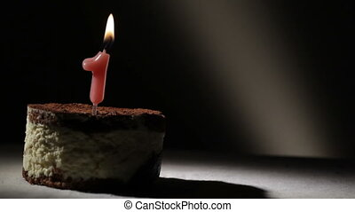 Candle one in tiramisu cake. Birthday vintage background.