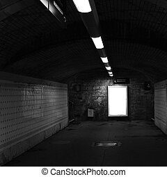 Railway station tunnel - Dark railway station tunnel with...