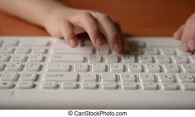 Child typing on a keyboard. Dolly s