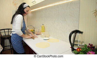 Home Baking - Woman Rolling Dough On Counter Top